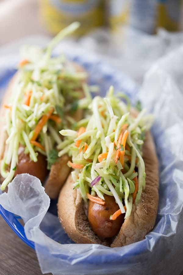 A spicy broccoli slaw tops these easy grilled chicken sausages. lemonsforlulu.com