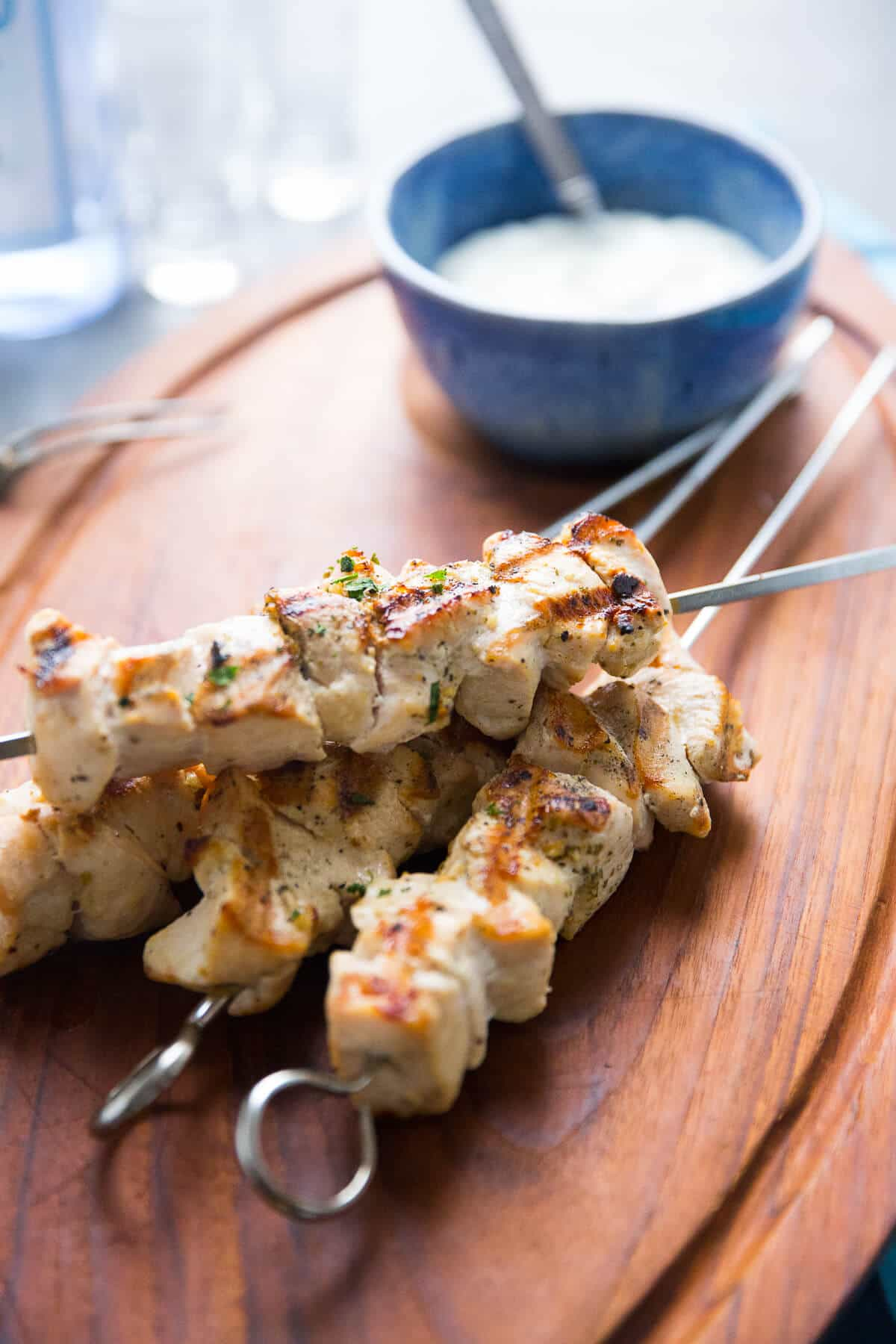 Greek chicken souvlaki on the grill is a great weeknight meal option. The skewers take minutes to grill up!