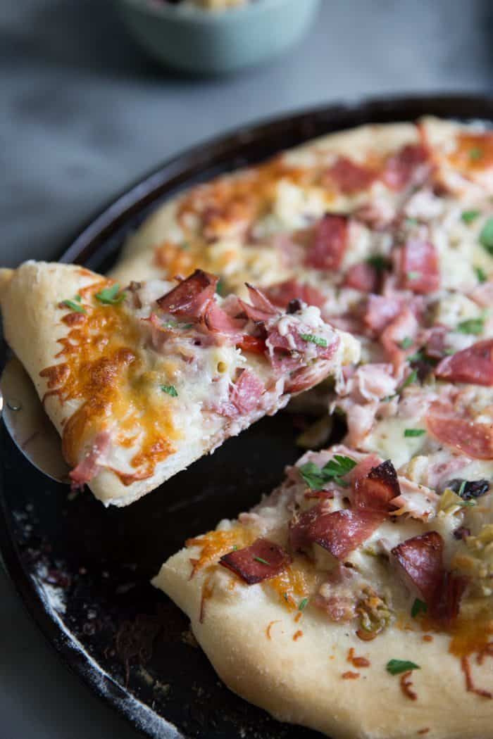 muffuletta sandwich pizza slice lifted
