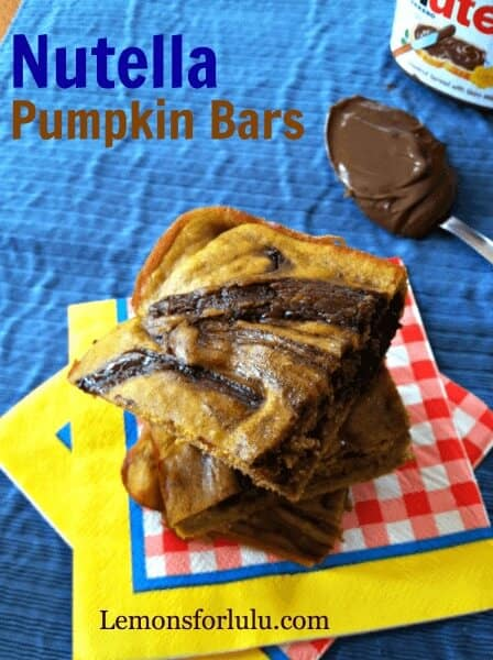 Easy Pumpkin Bars with a thick swirl of Nutella running throughout!  A match made in heaven! lemonsforlulu.com