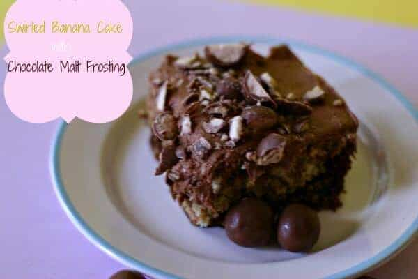 A soft chocolate and banana cake is topped with the silkiest malted frosting and  malted milk balls for garnish! lemonsforlulu.com