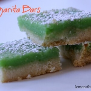 These bars feature a shortbread crust and a margarita filling. This easy dessert will be the life of the party! lemonsforlulu.com
