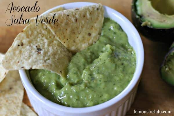 This salsa is filled with fresh avocado and tomatillos!  It is creamy ad flavorful.  A great dip or topping for tacos, chicken or even burgers! lemonsforlulu.com