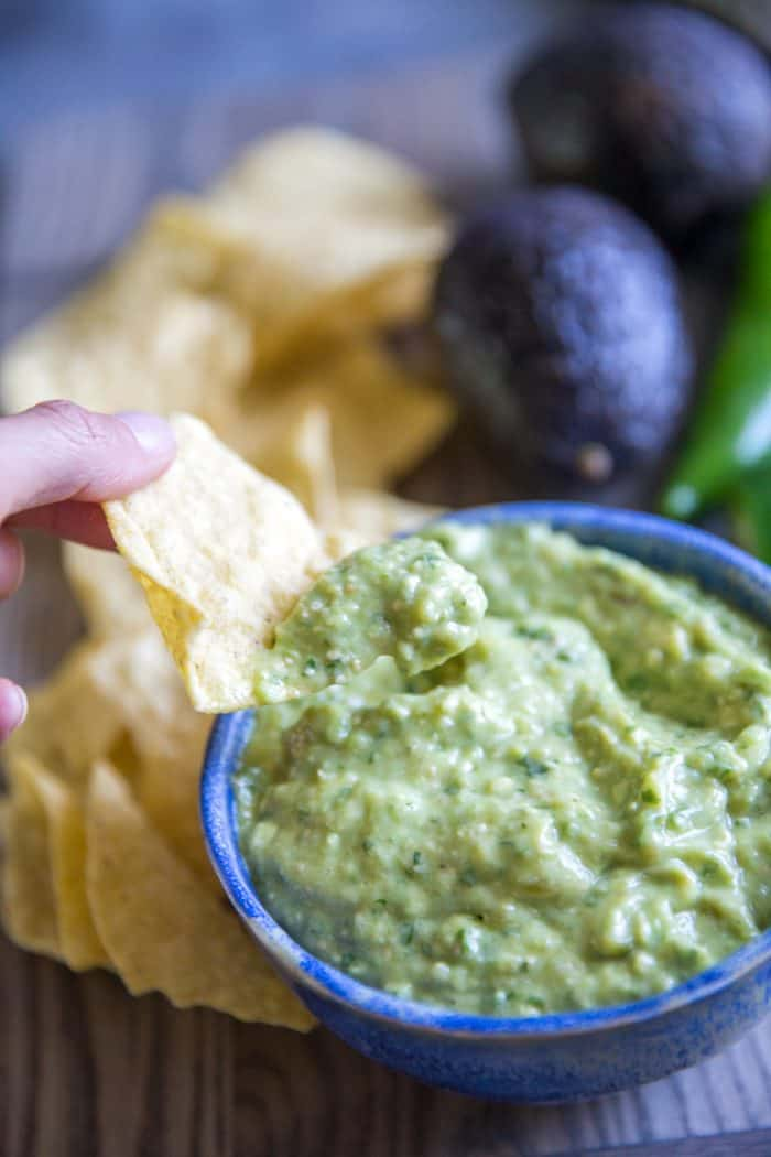 green salsa chip dipped