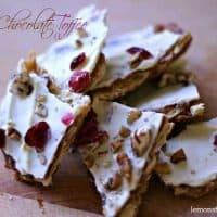 Saltine toffee with a caramel toffee sauce and white chocolate coating. Nuts and cherries add a burst of texture and flavor! lemonsforlulu.com