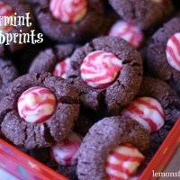 Chocolate dipped thumbprint cookies filled with a minty kiss candy! lemonsforlulu.com