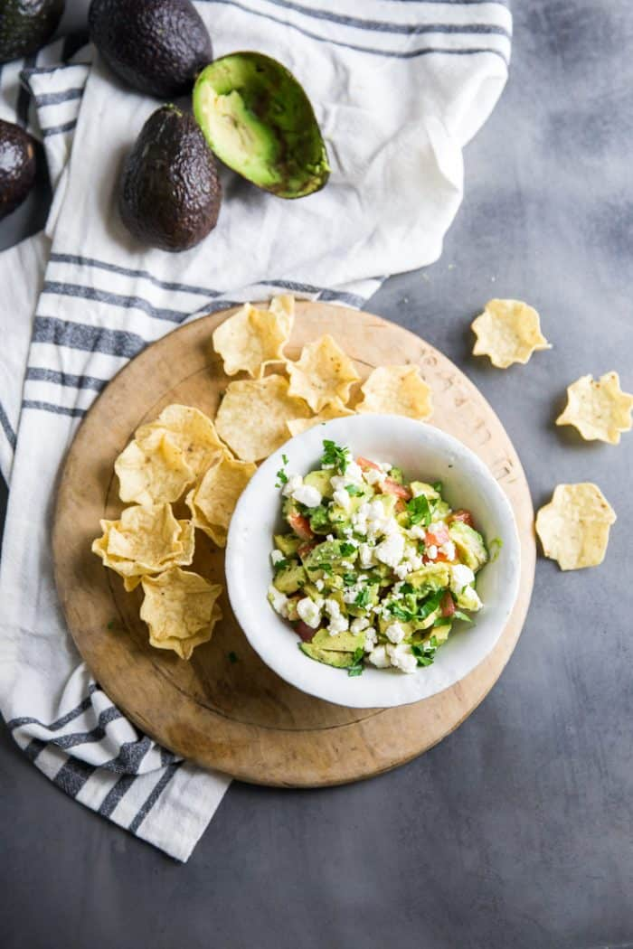 Avocado salsa with chips and avocado on the side