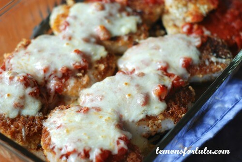 Pork Parmesan is the new favorite substitute for chicken Parmesan!  Breaded pork chops are browned on the stove and finished in the oven.  Each chop is smothered in melted cheese and   homemade pasta sauce!