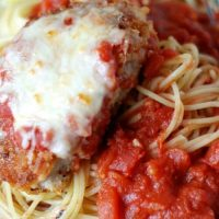 Pork Parmesan is the new favorite substitute for chicken Parmesan! Breaded pork chops, smothered in melted cheese and homemade pasta sauce! | lemonsforlulu.com