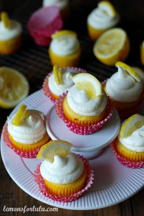 Assortment of Lemon Cupcakes with White Chocolate Buttercream on a white platter.
