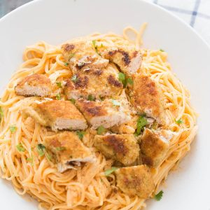 Chicken fettuccine alfredo like you've never tasted! Pasta noodles are coated with a light and creamy buffalo flavored alfredo sauce then topped with seasoned baked chicken!