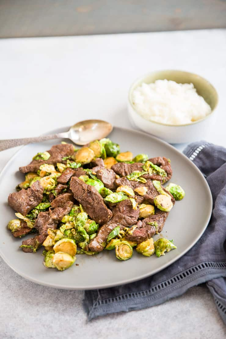 beef stir fry on a gray plate