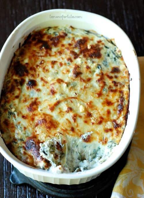 Creamy and cheesy spiced spinach and artichoke dip. www.lemonsforlulu.com