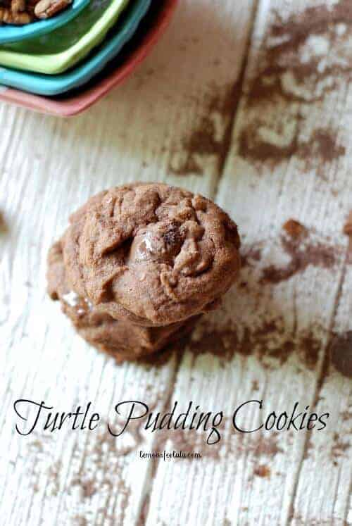 Chocolate pudding cookies stacked on a wooden table.