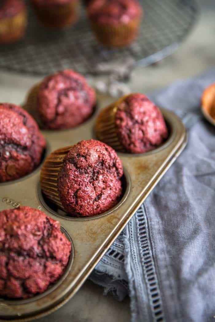 red velvet chocolate chip muffins in a tin