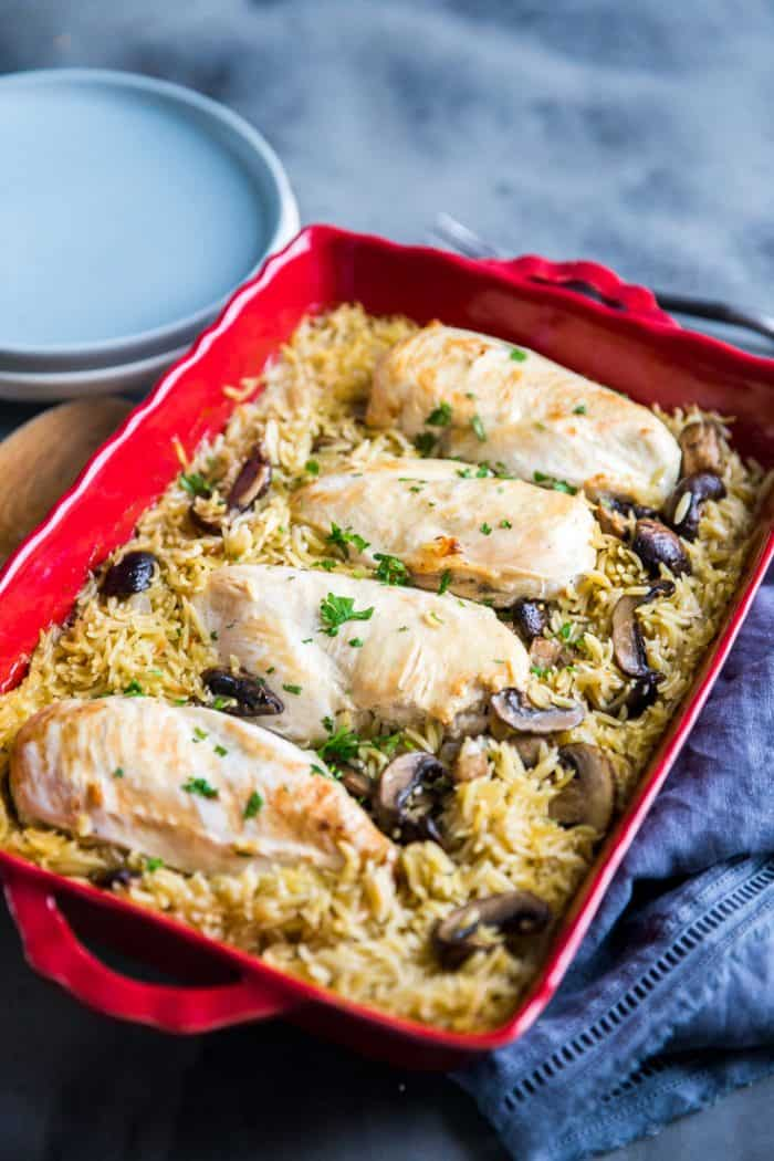 Baked chicken in red baking dish