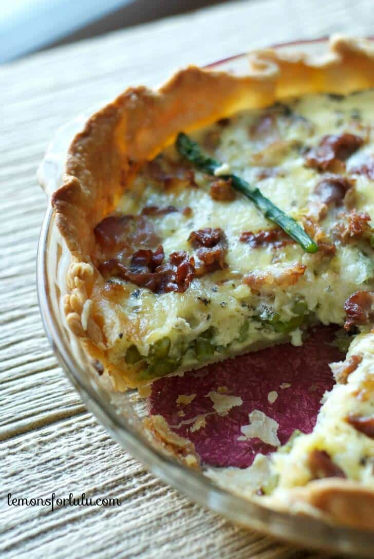 Perfect for spring! This quiche is made with asparagus, pancetta and guyere cheese! www.lemonsforlulu.com