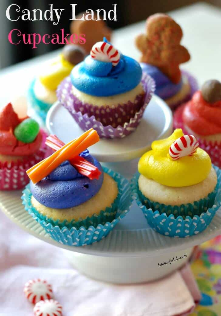 Candy Land cupcakes are topped with sugar and spice on a cake platter.