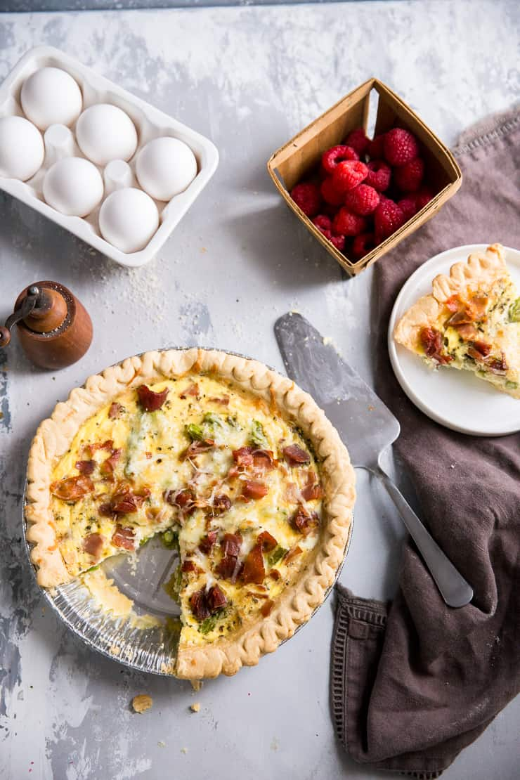 easy quiche recipe whole pie with a slice on the side
