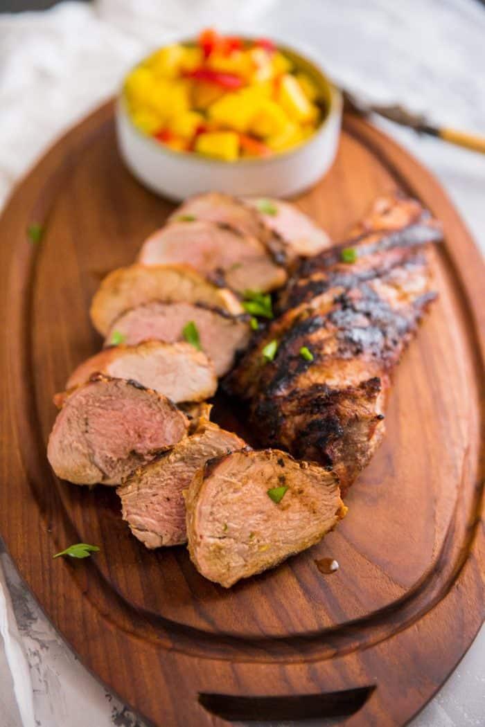 Grilled pork tenderloin on a cutting board