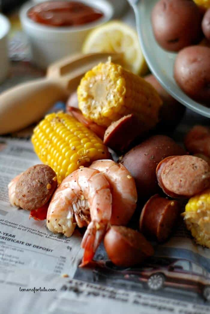 Shrimp, spices, potatoes, sausage and corn!  Finger food at it's best! www.lemonsforlulu.com