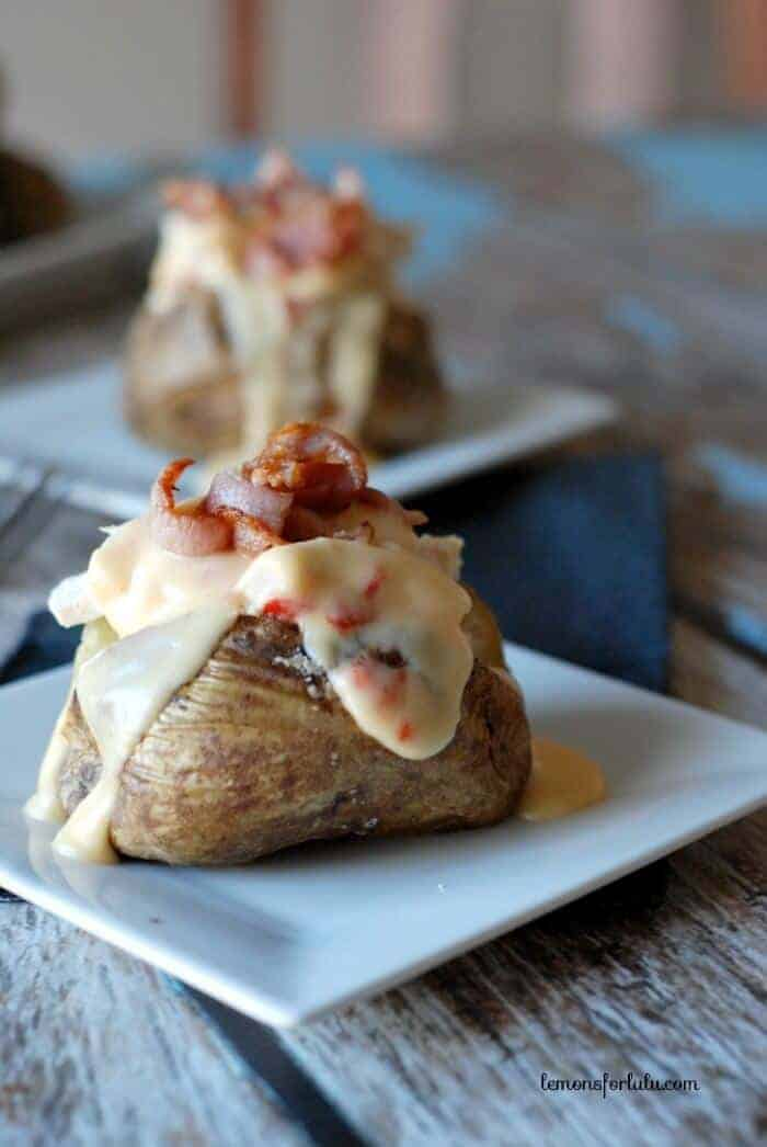 Hot Brown Baked Potato   lemonsforlulu.com, oven baked baked potato topped with chicken, a rich cheese sauce and crispy bacon!