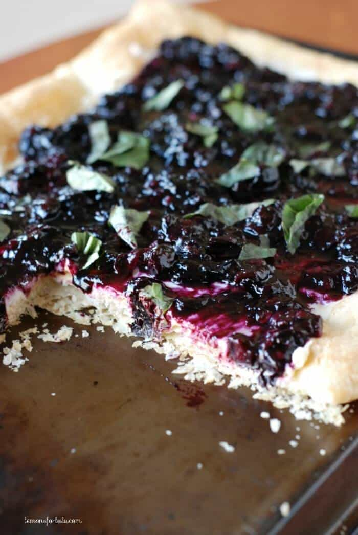 Slow roasted blueberry tart with mascarpone and goat cheese all on a flaky puff pastry crust! www.lemonsforlulu.com