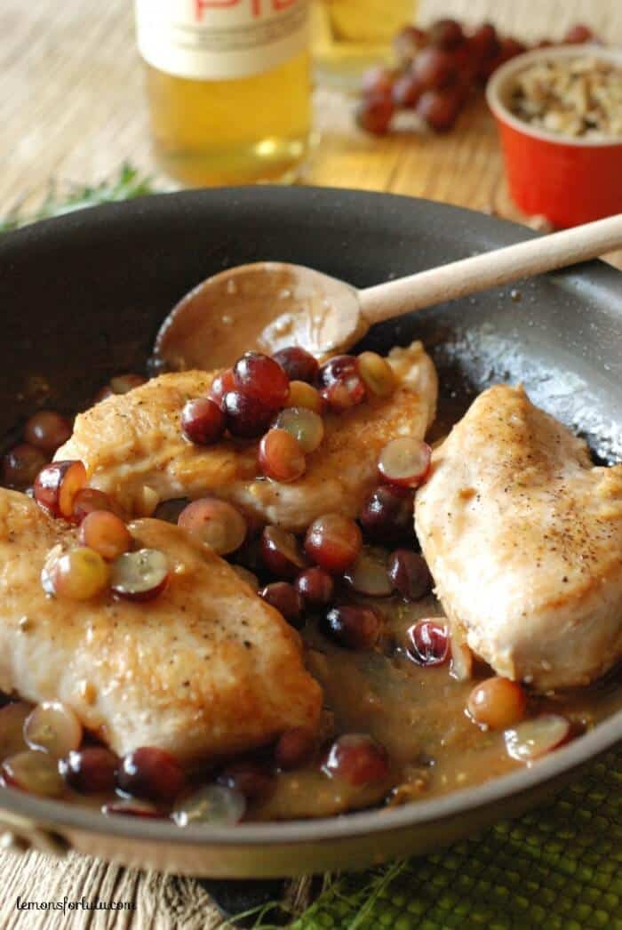A simple chicken dish made with red grapes, tangy blue cheese, toasted walnut all in a sweet wine (mead) sauce! www.lemonsforlulu.com