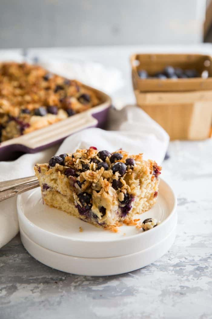 Blueberry coffee cake recipe piece on a white plate