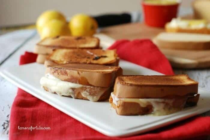 Tart lemon curd and creamy mascarpone cheese hidden between sweet pound cake for a dessert grilled cheese! www.lemonsforlulu.com