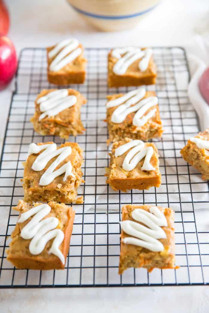 Apple carrot cake bars on a baking rack