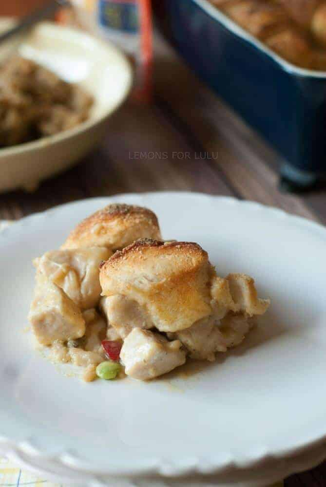 This chicken pot pie is so kid friendly and kid approved! The biscuit topping makes this chicken pot pie come tomgether quickly. It's a great way to get kids cooking! www.lemonsforlulu.com