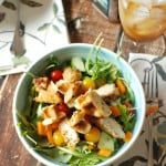 A simple chicken salad with sweet Belgian waffles, cherry tomatoes and arugula. A maple mustard dressing tops it off!