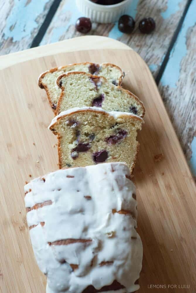 Cherry Almond Quick Bread - This quick bread is the perfect way to use up seasonally fresh cherries! Recipe at lemonsforlulu.com