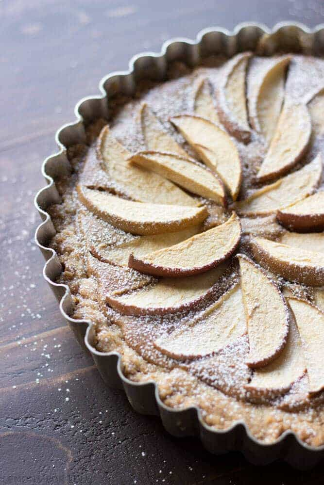 This easy apple tart takes not time to prepare but looks completely impressive! A fool proof crust and a creamy peanut butter filling will have you saying goodbye to traditional apple pie! www.lemonsforlulu.com