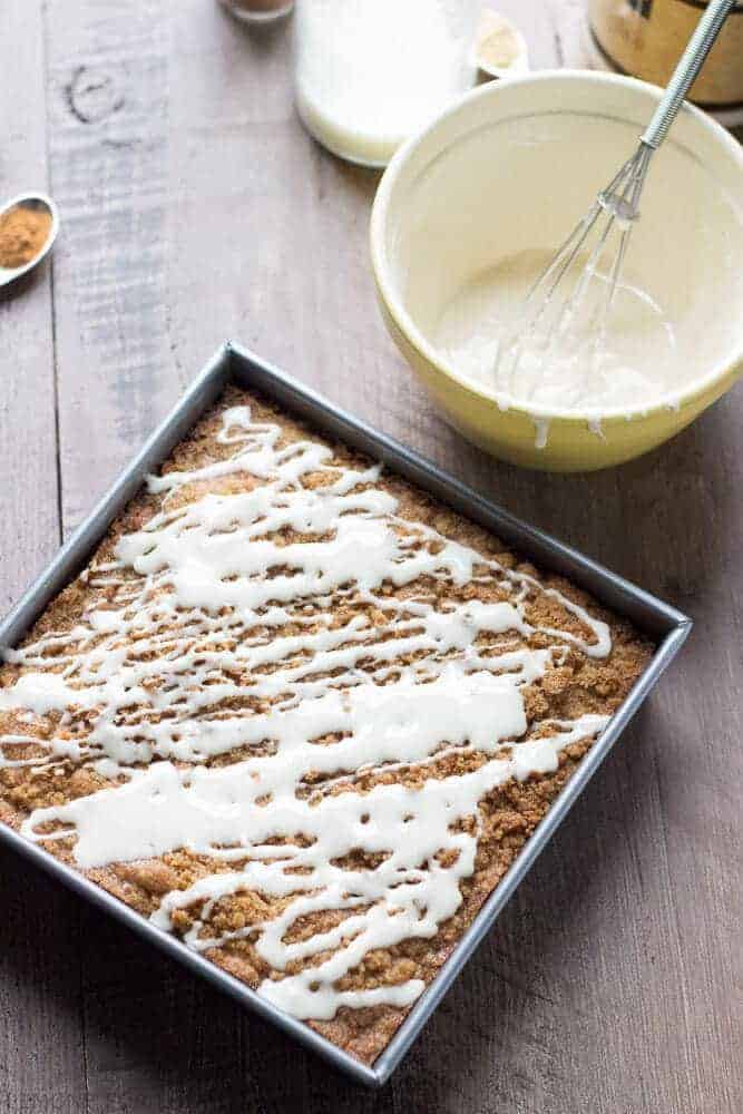 This coffee cake is festive and easy! A ginger streusel and a maple glaze make this coffee cake outstanding! www.lemonsforlulu.com #Fleischmann's Yeast