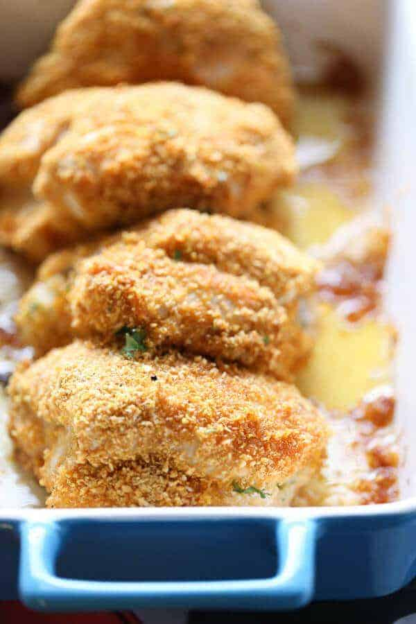 chicken kiev is coated in a perfectly seasoned coating then wrapped around herbed butter spread and baked up to absolute perfection!! lemonsforlulu.com
