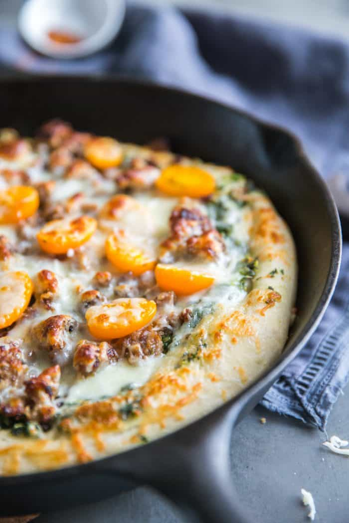 Sausage pizza with yellow tomatoes