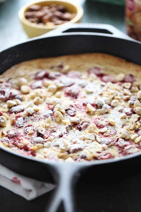 Fresh raspberries and crunchy toasted hazelnuts grace this simple Dutch baby! Enjoy this for breakfast, brunch or dessert! #IDelight #Ad
