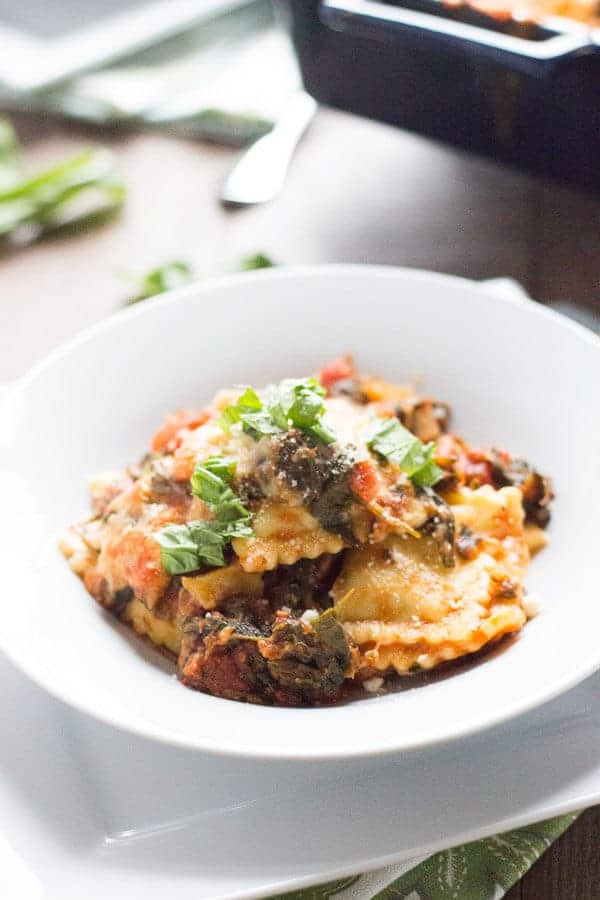 This easy ravioli lasagna will have dinner on the table quickly! Meat filled ravioli and a simple homemade spinach marinara sauce make this meal perfect for any night of the week. lemonsforluu.com
