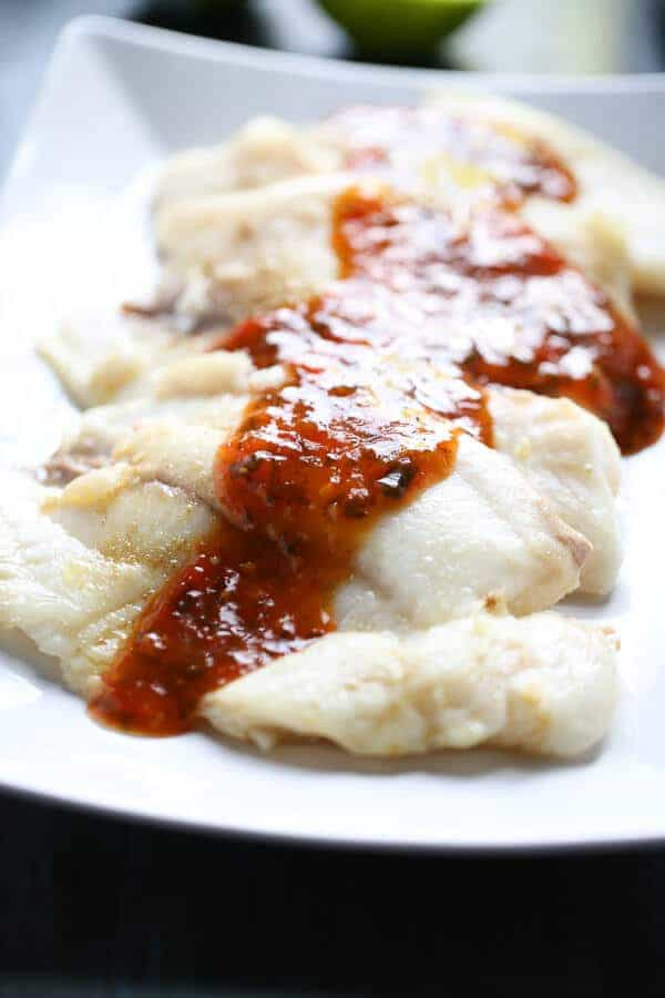 Chili Cilantro Tilapia Recipe with a bold and flavorful sauce that will knock your socks off! lemonsforlulu.com