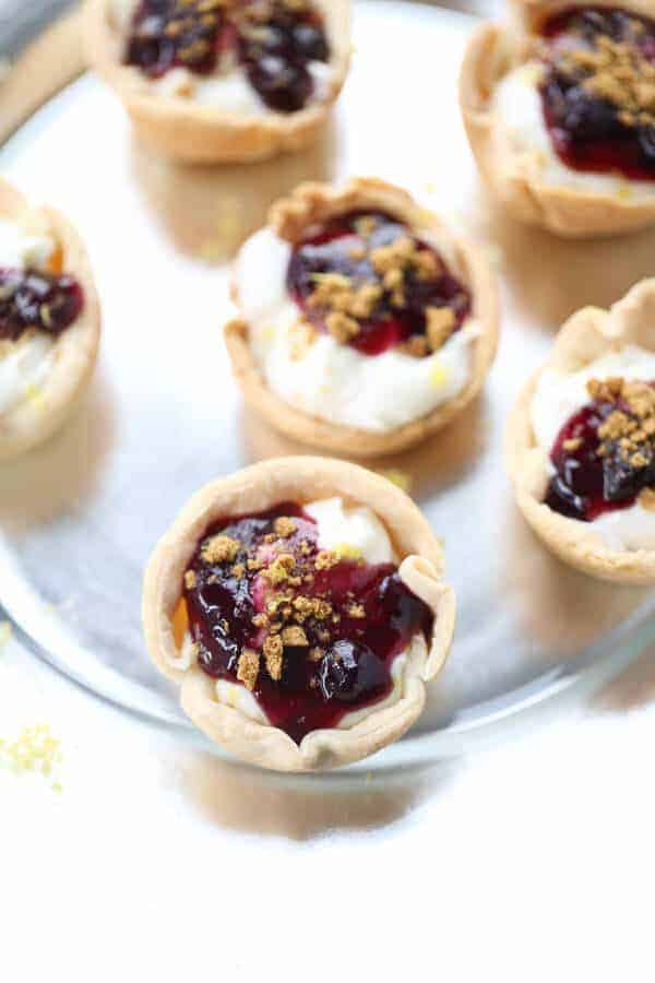 Lemon Blueberry Mini Pies are the perfect two bite desserts! They are light, tangy and perfectly tasty! lemonsforlulu.com