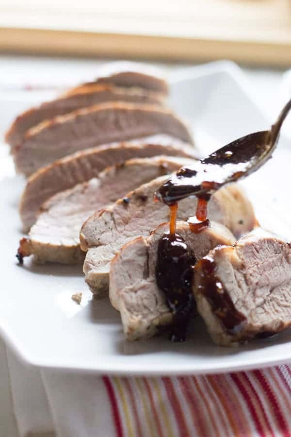 Oven roasted pork tenderloin is served with a tangy, sweet balsamic fig sauce! lemonsforlulu.com