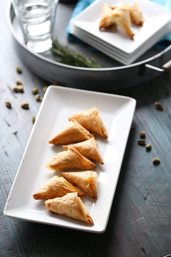 Golden fillo dough is folded around a creamy, salty, sweet filling for an outstanding appetizer ! lemonsforlulu.com