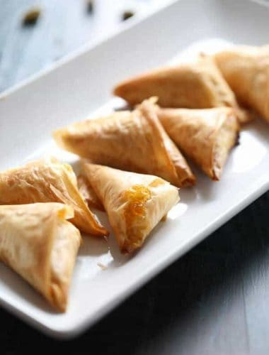 Flakey filo dough is wrapped around cream cheese, pistachios and apricot preserves. Not your ordinary appetizer! lemonsforlulu.com
