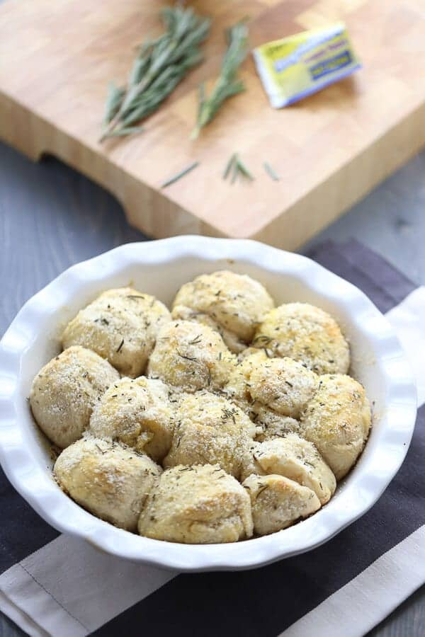 Soft, tender Rosemary Parmesan Potato Rolls are a must for any table! lemonsforlulu.com #BecomeABetterBaker