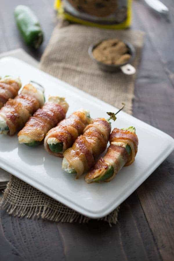 Blue cheese stuffed jalapenos are wrapped in sweet and crispy bacon! lemonsforlulu.com #SplendaSweeties #SweetSwap