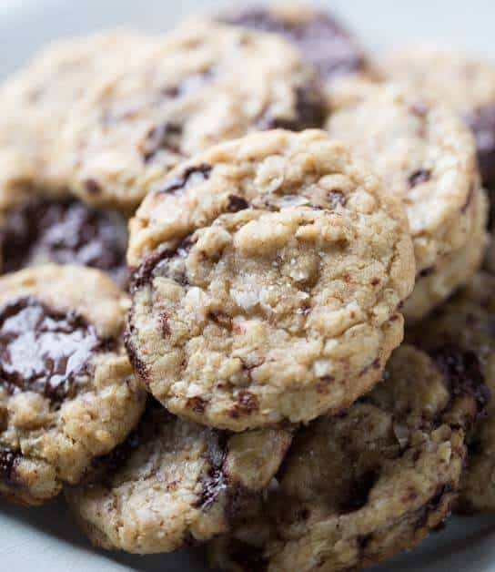 Browned butter cookies with coconut, oats, darck chocolate and a sprinkling of sea salt. They are soft in the center and crisp on the edges, just like a cookie should be! lemonsforlulu.com