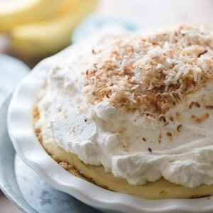 Coconut banana cream pie has a thick custard base, packed with the tropical taste of coconut and roasted bananas! lemonsforlulu.com