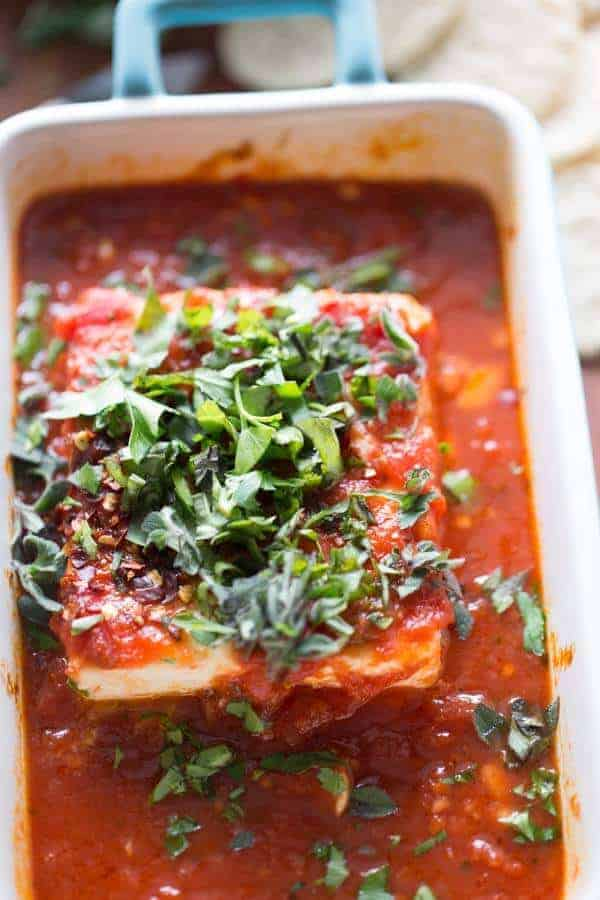 Baked feta appetizer that is spicy, saucy, savory and fresh! lemonsforlulu.com